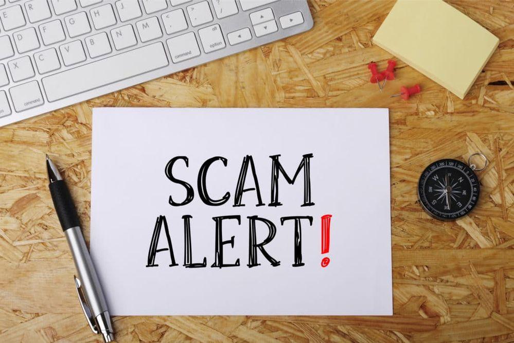 scam-alert-sketch-pen-desk-keyboard-1068x713.jpg